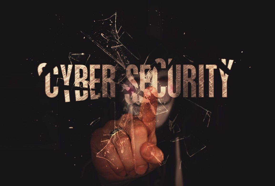 Finger touching the word cyber security and shattering the word