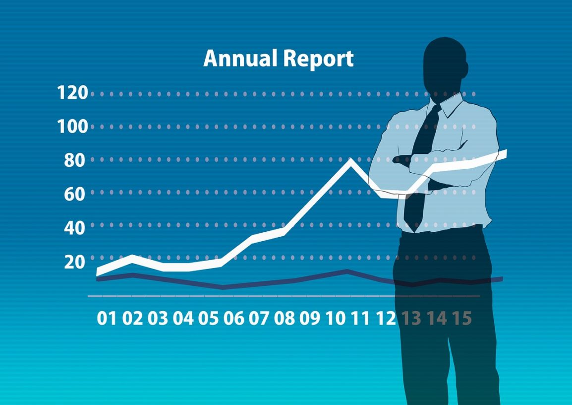 Cartoon man with crossed arms looking at an annual report line graph